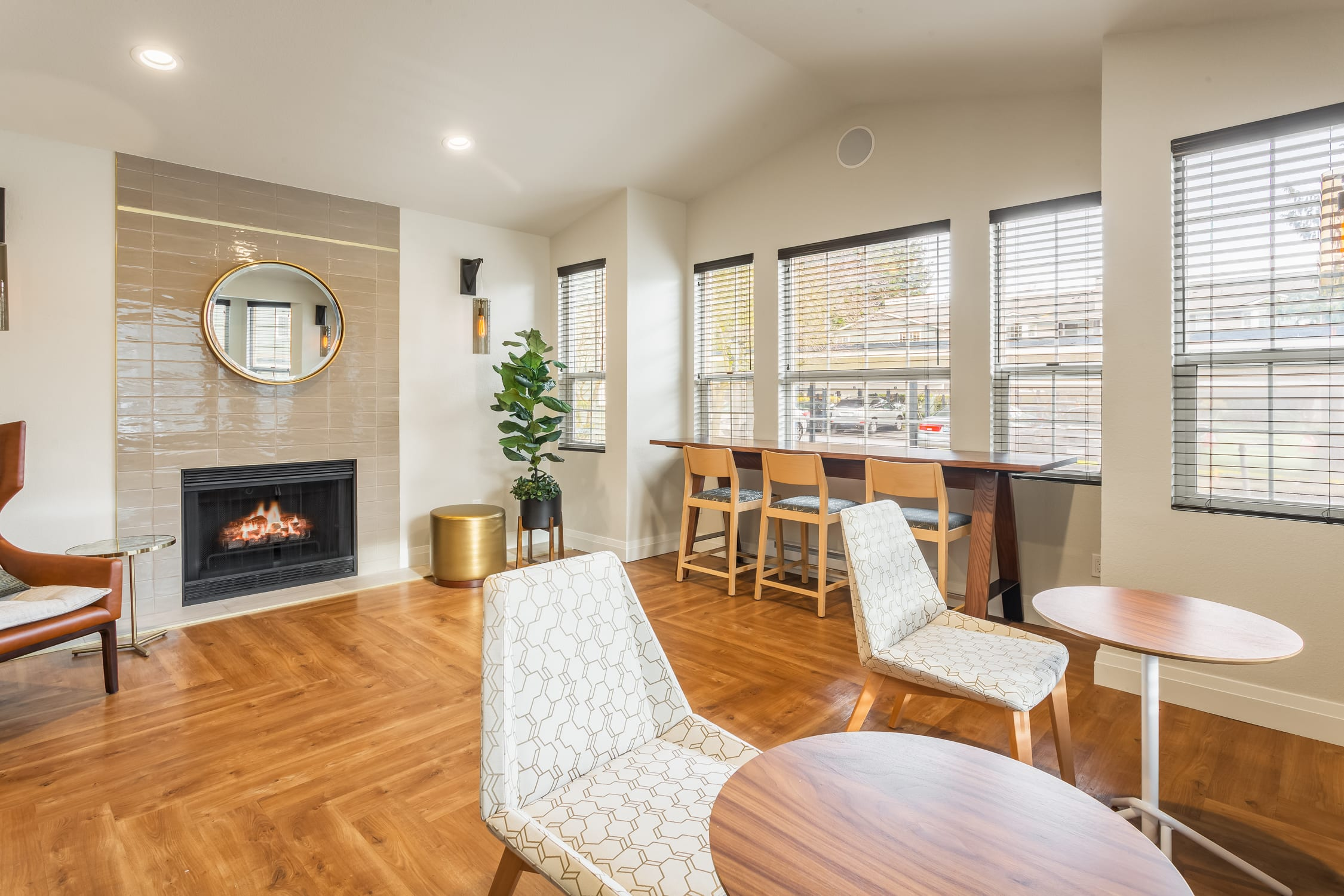 The common area at Haller Post Apartments has a fireplace and places to relax.
