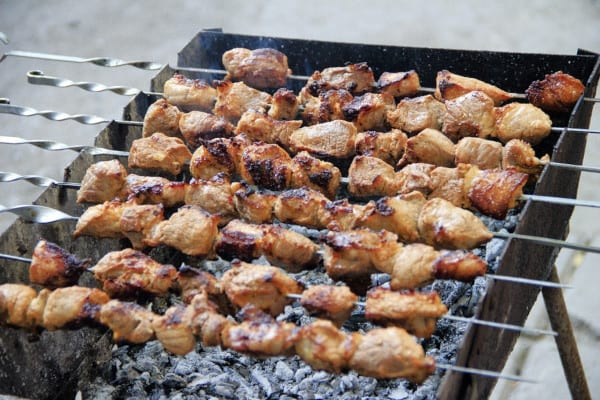 chicken kebab skewers on charcoal grill